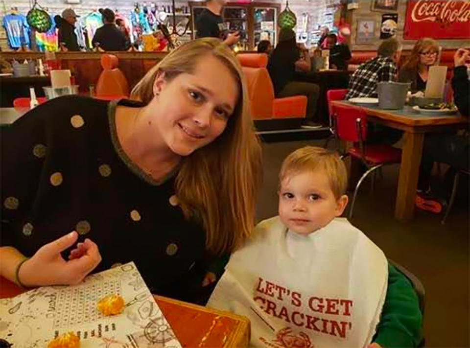 Shana Pringle sits with her son Noah in a restaurant.