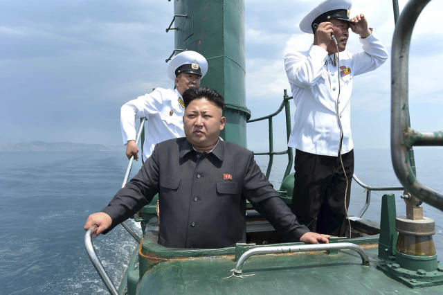 <p>North Korean leader Kim Jong Un, front, stands on the conning tower of a submarine during his inspection of the Korean People's Army (KPA) Naval Unit 167 in this undated photo. (KCNA/Reuters) </p>