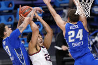 Gonzaga forward Anton Watson (22) drives between Creighton forward Christian Bishop (13) and Mitch Ballock (24) in the first half of a Sweet 16 game in the NCAA men's college basketball tournament at Hinkle Fieldhouse in Indianapolis, Sunday, March 28, 2021. (AP Photo/AJ Mast)