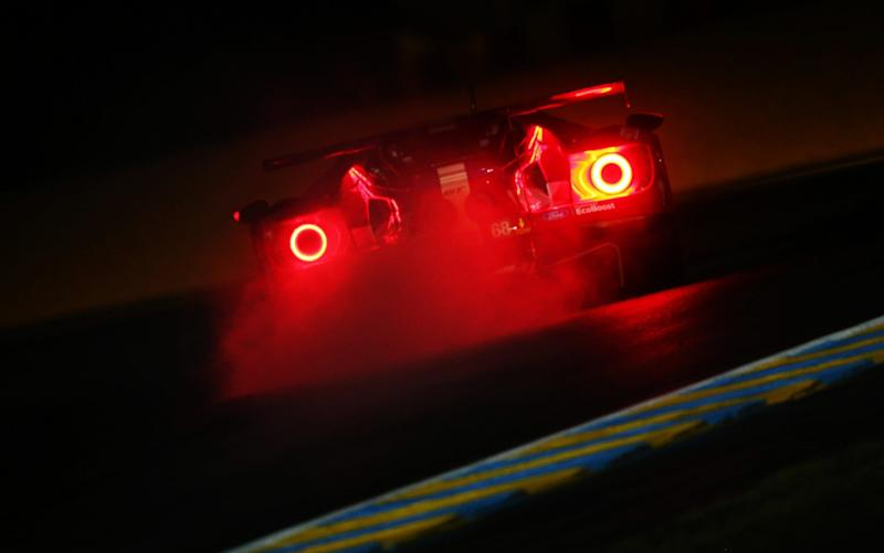 The tail lights of a Ford GT pierce the gloom of Le Mans practice yesterday - Getty Images Europe