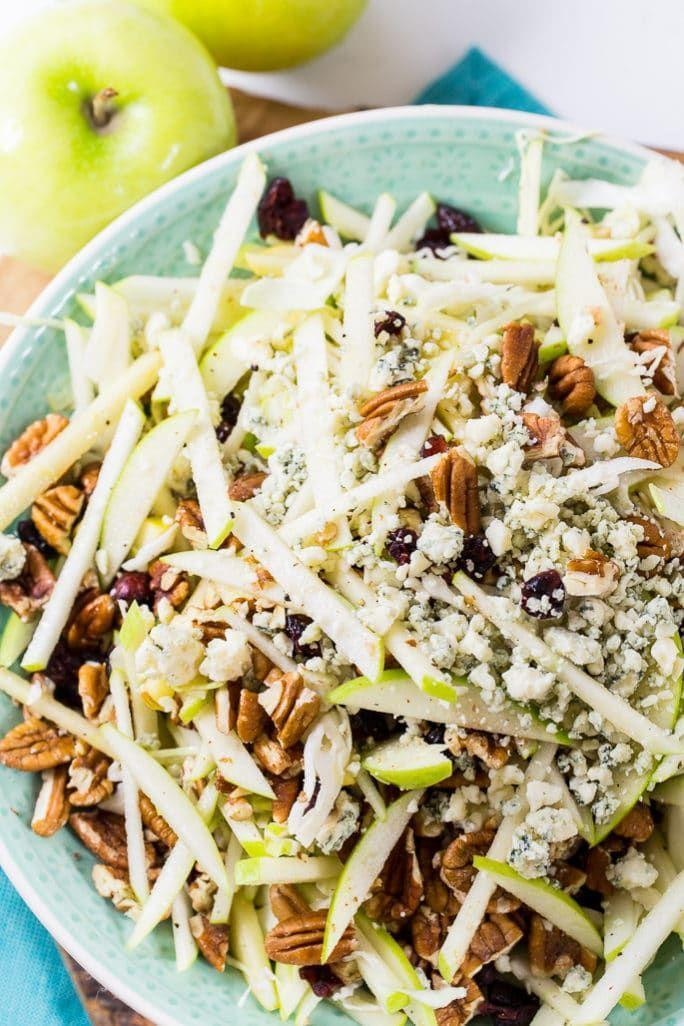 """<p>This is a simple salad to serve as refreshing side. It's got cabbage instead of lettuce, so it's tastes similar to a slaw.</p><p><strong>Get the recipe at <a href=""""https://spicysouthernkitchen.com/apple-maple-pecan-salad/"""" rel=""""nofollow noopener"""" target=""""_blank"""" data-ylk=""""slk:Spicy Southern Kitchen"""" class=""""link rapid-noclick-resp"""">Spicy Southern Kitchen</a>.</strong> </p>"""