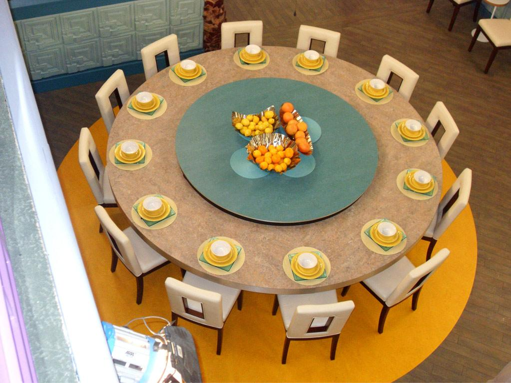 The current dining table can seat 12. Come August, it will be replaced with a smaller table, once half of the Houseguests have been evicted.