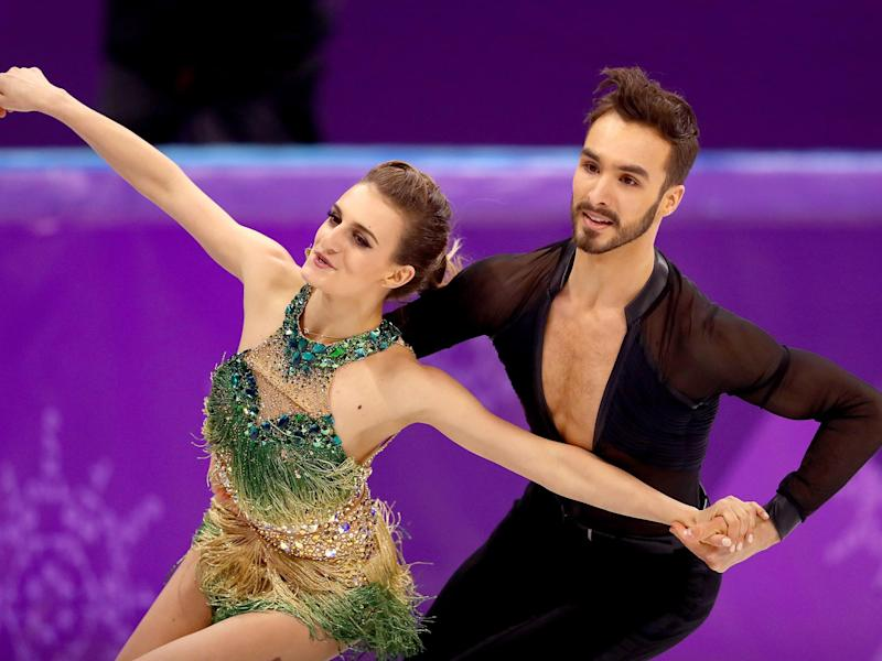 Gabriella Papadakis bravely completed her routine with Guillaume Cizeron after suffering a wardrobe malfunction: Getty