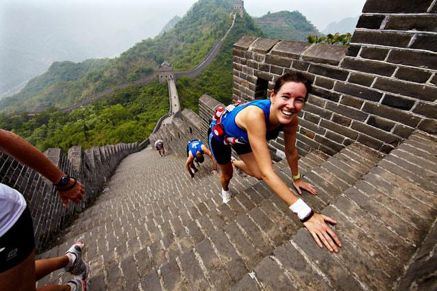 Great Wall Marathon 2009. Photo: Klaus Sletting, Albatros Travel - Needless to say, the view is incredible. Apart from the steep ascents, descents and thousands of steps of the first nine kilometres over the wall, the course also runs through asphalt roads, rice paddies and villages. The Yin and Yang Square at the Huanyaguang section of the Great Wall, Tianjin province, is the start and finish point of the race, which is also where lunch and massage services will be held.