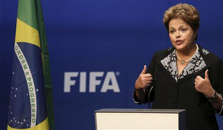 Brazil's President Dilma Rousseff delivers a statement at the FIFA headquarters in Zurich January 23, 2014. The 2014 World Cup finals will be held in Brazil from June 12 through July 13. REUTERS/Thomas Hodel