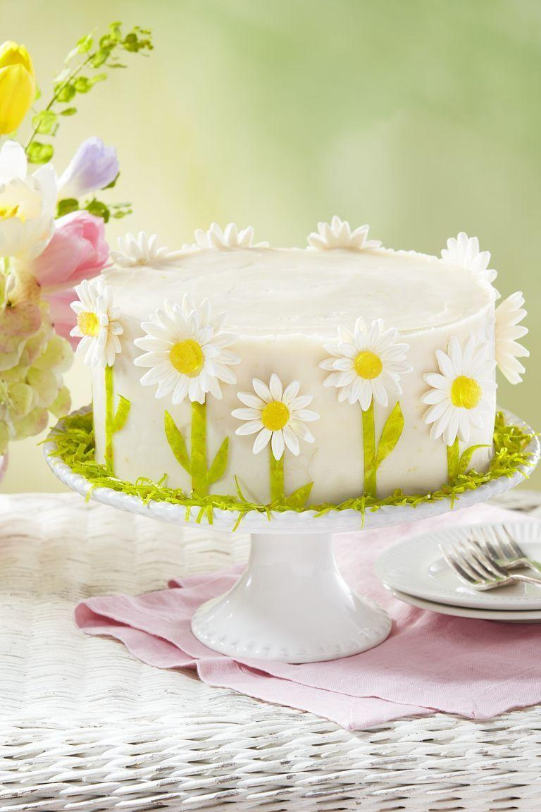 """<p>Make this beautiful layered lemon cake for a Mother's Day gathering that just screams spring.</p><p><strong><a href=""""https://www.countryliving.com/food-drinks/a30875358/spring-daisy-lemon-layer-cake-recipe/"""" rel=""""nofollow noopener"""" target=""""_blank"""" data-ylk=""""slk:Get the recipe"""" class=""""link rapid-noclick-resp"""">Get the recipe</a>.</strong></p><p><strong><a class=""""link rapid-noclick-resp"""" href=""""https://www.amazon.com/Mind-Reader-GALCAKE-SIL-Ceramic-Galvanized/dp/B07QGG8YXN/?tag=syn-yahoo-20&ascsubtag=%5Bartid%7C10050.g.4238%5Bsrc%7Cyahoo-us"""" rel=""""nofollow noopener"""" target=""""_blank"""" data-ylk=""""slk:SHOP CAKE STANDS"""">SHOP CAKE STANDS</a><br></strong></p>"""