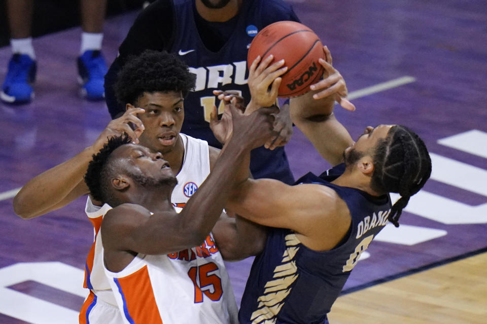 Florida forward Osayi Osifo (15) tries to steal the ball from Oral Roberts forward Kevin Obanor, right, during the first half of a college basketball game in the second round of the NCAA tournament at Indiana Farmers Coliseum, Sunday, March 21, 2021 in Indianapolis. (AP Photo/AJ Mast)