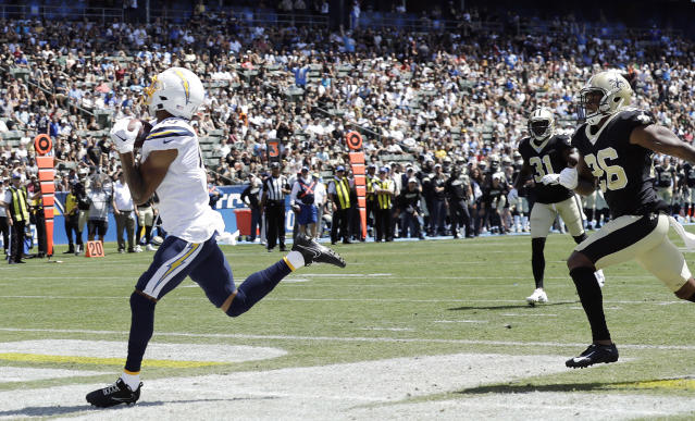 Los Angeles Chargers wide receiver Andre Patton, left, makes a touchdown reception against the New Orleans Saints during the first half of a preseason NFL football game Sunday, Aug. 18, 2019, in Carson, Calif. (AP Photo/Gregory Bull)