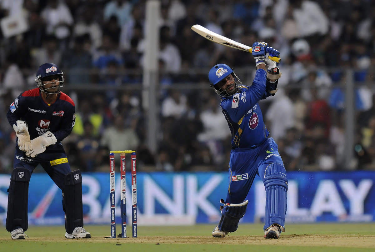 Dinesh Karthik of Mumbai Indians bats during match 10 of the Pepsi Indian Premier League ( IPL) 2013  between The Mumbai Indians and the Delhi Daredevils held at the Wankhede Stadium in Mumbai on 9th April 2013 ..Photo by Pal Pillai-IPL-SPORTZPICS ..Use of this image is subject to the terms and conditions as outlined by the BCCI. These terms can be found by following this link:..https://ec.yimg.com/ec?url=http%3a%2f%2fwww.sportzpics.co.za%2fimage%2fI0000SoRagM2cIEc&t=1506404697&sig=yzS5r9dKlgcX6obpARPsPA--~D