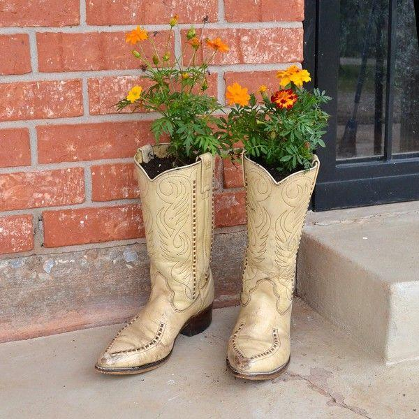 """<p>Yee-haw! These planters made from well-worn cowboy boots are perfect for displaying seasonal blooms.</p><p><strong><span>Get the tutorial at </span><a href=""""https://www.dreamalittlebigger.com/post/cowboy-boot-planters.html"""" rel=""""nofollow noopener"""" target=""""_blank"""" data-ylk=""""slk:Dream a Little Bigger"""" class=""""link rapid-noclick-resp"""">Dream a Little Bigger</a><span>.</span></strong></p><p><a class=""""link rapid-noclick-resp"""" href=""""https://go.redirectingat.com?id=74968X1596630&url=https%3A%2F%2Fwww.walmart.com%2Fip%2FHyper-Tough-20V-Max-Lithium-ion-Cordless-Drill-3-8-inch-Chuck-Variable-Speed-with-1-5Ah-Lithium-ion-Battery-and-Charger-Bit-Holder-LED-Light%2F290983234&sref=https%3A%2F%2Fwww.thepioneerwoman.com%2Fhome-lifestyle%2Fgardening%2Fg36556911%2Fdiy-planters%2F"""" rel=""""nofollow noopener"""" target=""""_blank"""" data-ylk=""""slk:SHOP DRILLS"""">SHOP DRILLS</a></p>"""