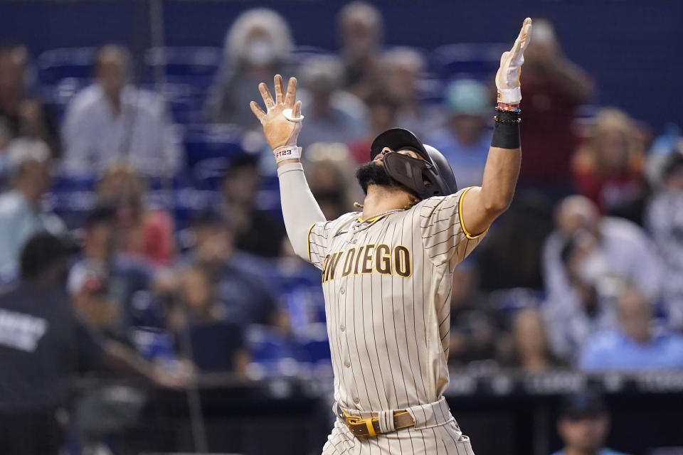 San Diego Padres' Fernando Tatis Jr. reacts as he crosses the plate with a solo home run during the first inning of a baseball game against the Miami Marlins, Saturday, July 24, 2021, in Miami. (AP Photo/Lynne Sladky)