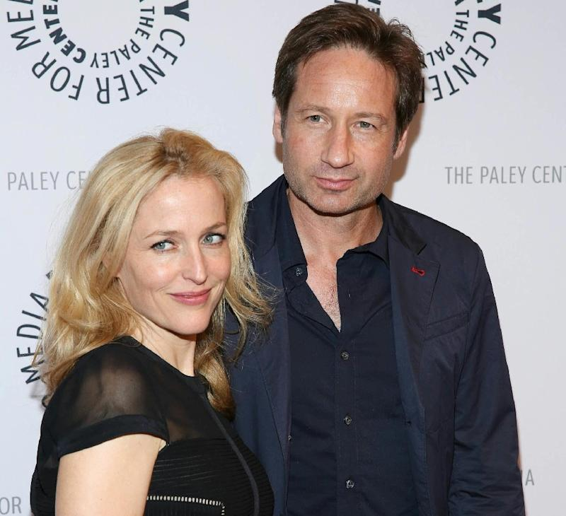 X-File stars David Duchovny (R) and Gillian Anderson (L) reunite in their roles as Fox Mulder, a hothead FBI agent investigating the inexplicable, and Dana Scully, his rational partner