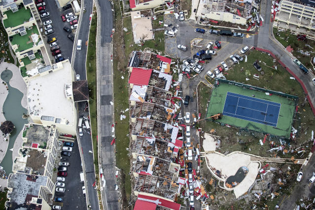 <p>Storm damage in the aftermath of Hurricane Irma, in St. Maarten. Irma cut a path of devastation across the northern Caribbean, leaving thousands homeless after destroying buildings and uprooting trees on Sept. 6, 2017. (Photo: Gerben Van Es/Dutch Defense Ministry via AP) </p>