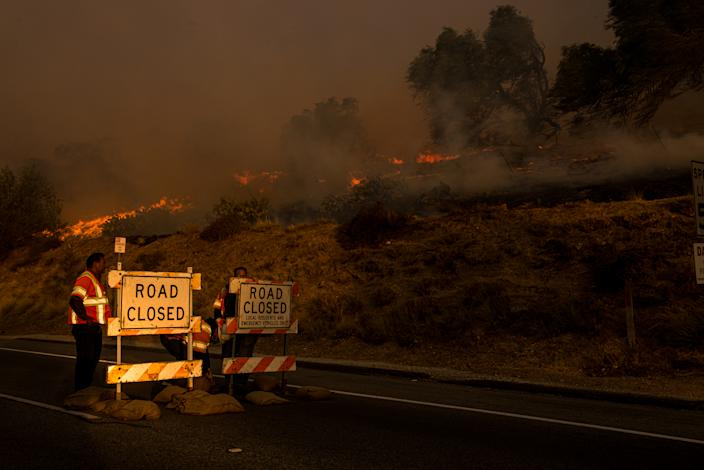 A road is closed to traffic as the Easy Fire burns in Simi Valley, California, on Oct. 30, 2019.  (Photo: Justin L. Stewart/ZUMA Wire)