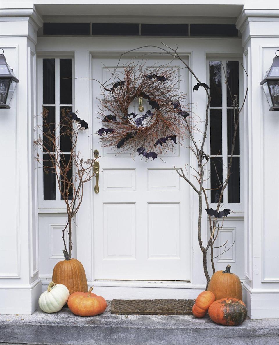 <p>It doesn't get easier than this: Simply add felt bats to a natural twig wreath to give trick-or-treaters a friendly fright. </p>