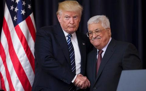 US President Donald J. Trump shakes hands with Palestinian President Mahmoud Abbas in May - Credit: EPA