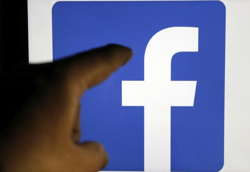 A Facebook logo is pictured on an Apple's Ipad in Bordeaux, southwestern France