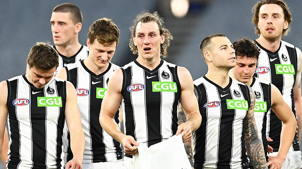 Collingwood walk off the field after their final AFL match of 2021.