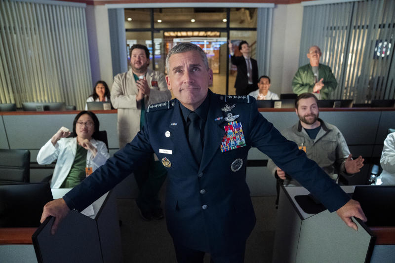 """This image released by Netflix shows Steve Carell, center, from the comedy series """"Space Force,"""" available for streaming on Netflix on Friday.  (Aaron Epstein/Netflix via AP)"""