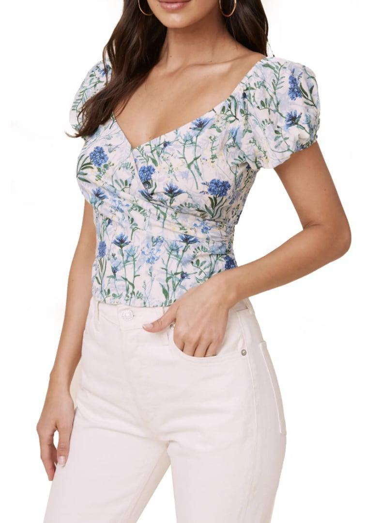 <p>Stomped on what to wear for your girls' brunch? This <span>ASTR the Label Floral Surplice Linen &amp; Cotton Crop Top</span> ($35, originally $59) is a failsafe choice.</p>