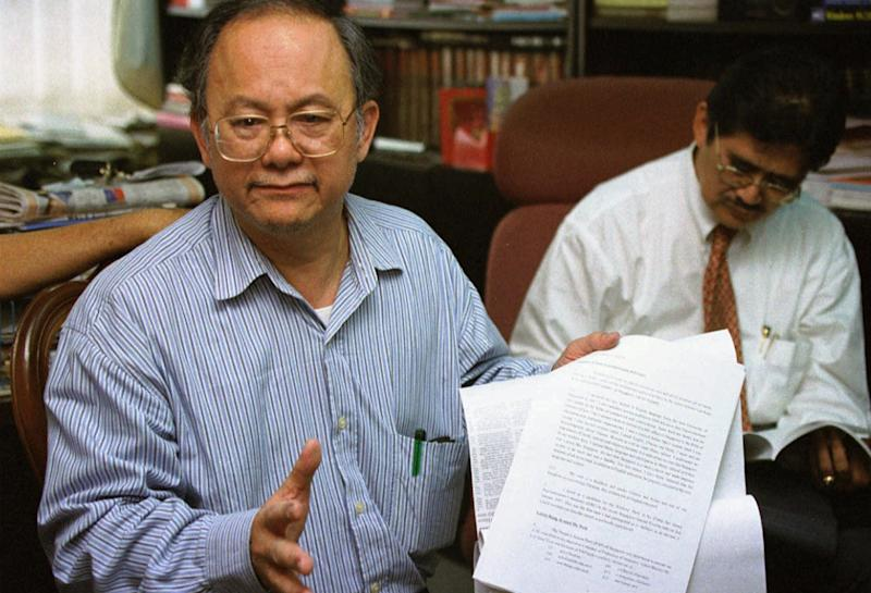 Singaporean politician and lawyer Tang Liang Hong, left, and his Malaysian lawyer Abdul Razak Ahmad meet with members of the press in Johor Bahru, Malaysia Tuesday, March 11, 1997. Tang, who fled Singapore, was found guilty of defaming Singapore's prime minister and other leaders and faces disciplinary action that could strip him of his license. The lawsuits stem from the contention that Tang called the leaders liars when he rejected their allegations that he was an anti-Christian Chinese nationalist bigot who could threaten the racial harmony of Singapore. (AP Photo/Bernama)