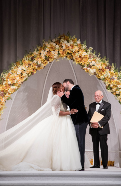 <p></p><p><span>Serena made her grand entrance in a Sarah Burton for Alexander McQueen wedding gown and cape. <i>[Photo: Vogue Magazine]</i></span> </p><p></p>