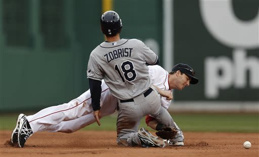 Boston Red Sox shortstop Stephen Drew cannot handle the throw as Tampa Bay Rays' Ben Zobrist (18) steals second base during the fourth inning of a baseball game at Fenway Park in Boston, Sunday, April 14, 2013. (AP Photo/Winslow Townson)