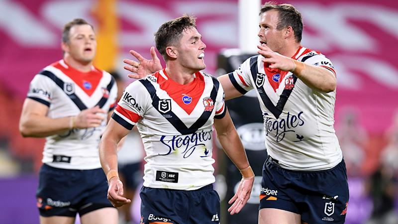 Roosters halfback Kyle Flanagan is seen here celebrates with teammates during an NRL game.