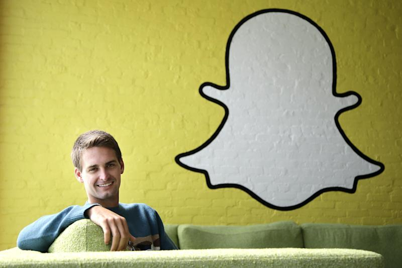 FILE - In this Thursday, Oct. 24, 2013, file photo, Snapchat CEO Evan Spiegel poses for a photo in Los Angeles. As Snap prepares to go public, following in the footsteps of Facebook and Twitter, the question is which one it will resemble more? Signs point both ways. Snapchat is popular with young people but its user growth has slowed in recent months, amid competition from Instagram and other social media apps. (AP Photo/Jae C. Hong, File)