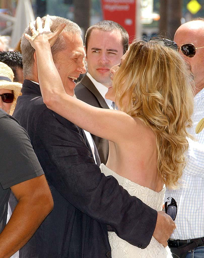 """Michelle Pfeiffer shares an embrace with her """"Fabulous Baker Boys"""" co-star Jeff Bridges as she receives her star on the Hollywood Walk of Fame. Gregg DeGuire/<a href=""""http://www.wireimage.com"""" rel=""""nofollow noopener"""" target=""""_blank"""" data-ylk=""""slk:WireImage.com"""" class=""""link rapid-noclick-resp"""">WireImage.com</a> - August 6, 2007"""