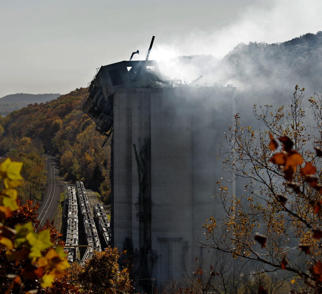 Smoke continues to rise from the damaged Bartlett Grain Company elevator in Atchison, Kan. Monday, Oct. 31, 2011. Six people were killed after a grain dust explosion rocked the facility Saturday night. The final three bodies were recovered Monday from the burnt wreckage of a Kansas grain elevator where a weekend explosion killed six people and injured two others, a company official said.  (AP Photo/Charlie Riedel)