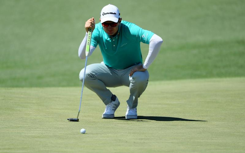 Justin Rose lines up a putt - Credit: Getty