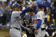 Los Angeles Dodgers' Justin Turner (10) celebrates with manager Dave Roberts (30) after Game 2 of the National League Championship Series baseball game against the Milwaukee Brewers Saturday, Oct. 13, 2018, in Milwaukee. The Dodgers won 4-3. (AP Photo/Jeff Roberson)