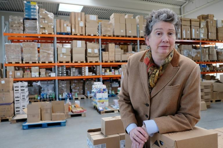 Juliane Kronen, founder of the Innatura cooperative, poses for a photo at a warehouse of the non-profit group, in Cologne, western Germany