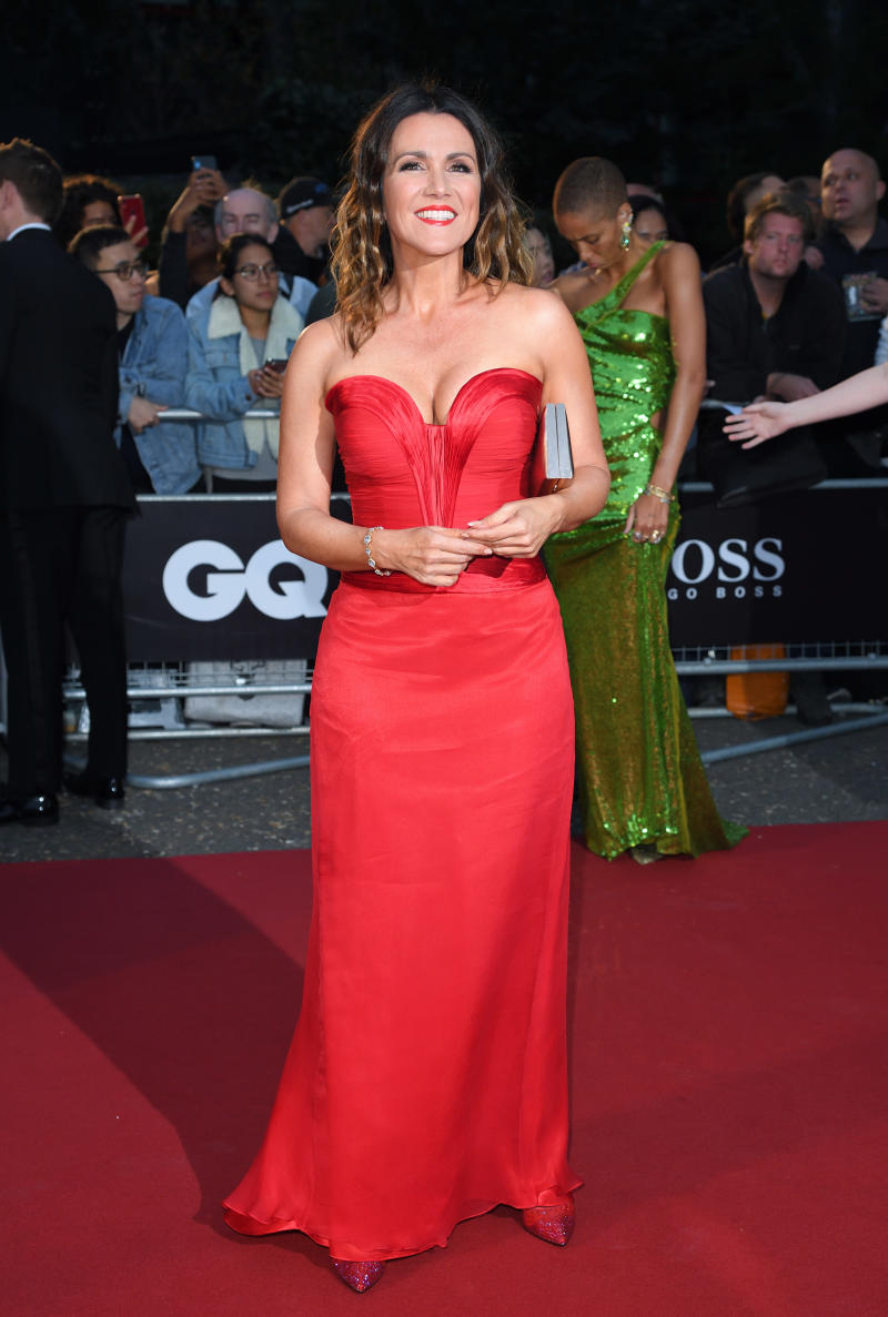 Susanna Reid attended the GQ Men Of The Year Awards 2019 in a bold red gown [Photo: Getty Images]