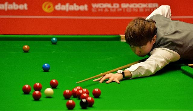 Xiao Guodong at the World Snooker Championship in 2014 (AFP Photo/ANDREW YATES)
