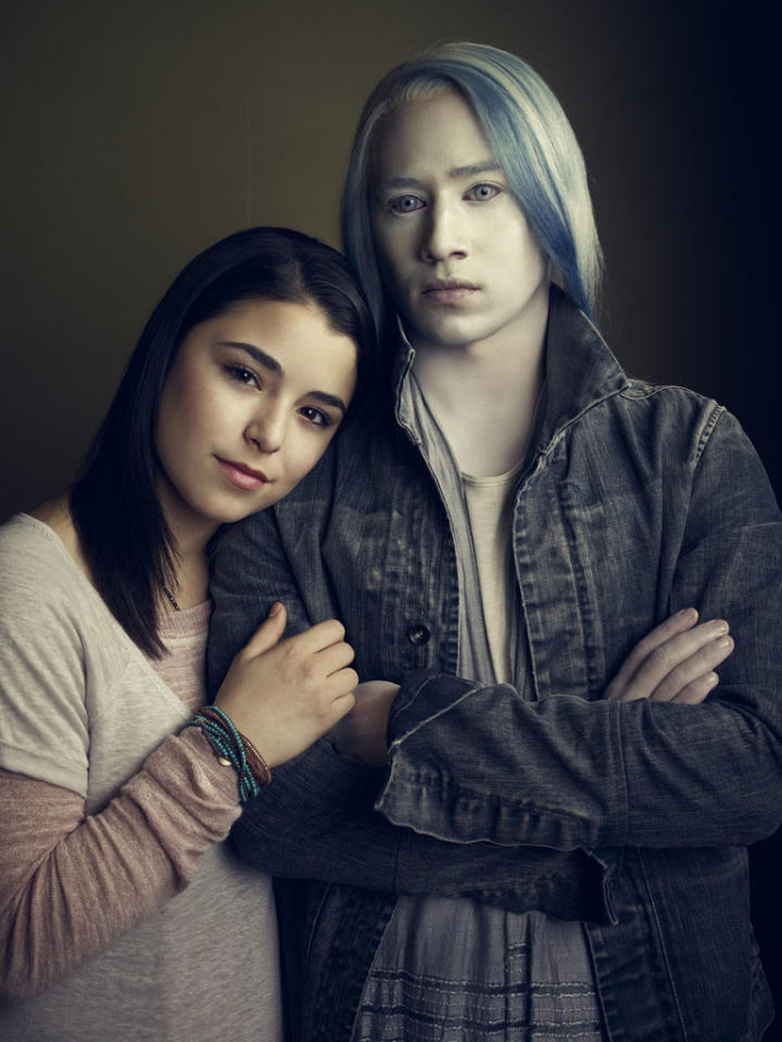 "Nicole Munoz as Christie McCawley and Jesse Rath as Alak Tarr on Syfy's ""Defiance."""