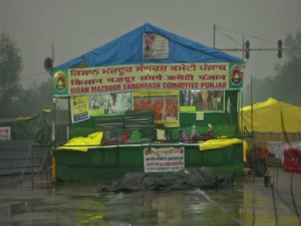 Farmers cover tents with plastic to avoid leaking