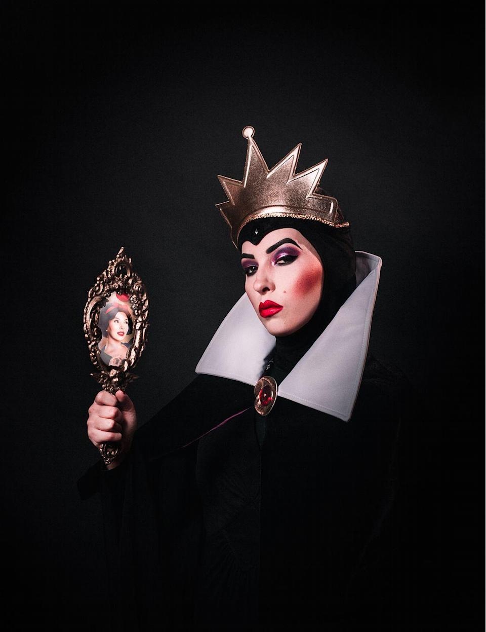 """<p>You can replicate this surprisingly simple costume with a black cape topped by a tall, white collar, a golden crown, and dramatic red lips. For extra points, line a hand mirror with a pic of Snow White to show who really is the fairest of them all.</p><p><strong>Get the tutorial at <a href=""""https://keikolynn.com/2019/10/disney-villains-halloween-costumes/"""" rel=""""nofollow noopener"""" target=""""_blank"""" data-ylk=""""slk:Keiko Lynn"""" class=""""link rapid-noclick-resp"""">Keiko Lynn</a>.</strong></p><p><a class=""""link rapid-noclick-resp"""" href=""""https://www.amazon.com/Red-Lipstick/s?k=Red+Lipstick&tag=syn-yahoo-20&ascsubtag=%5Bartid%7C10050.g.36674692%5Bsrc%7Cyahoo-us"""" rel=""""nofollow noopener"""" target=""""_blank"""" data-ylk=""""slk:SHOP RED LIPSTICK"""">SHOP RED LIPSTICK</a><br></p>"""