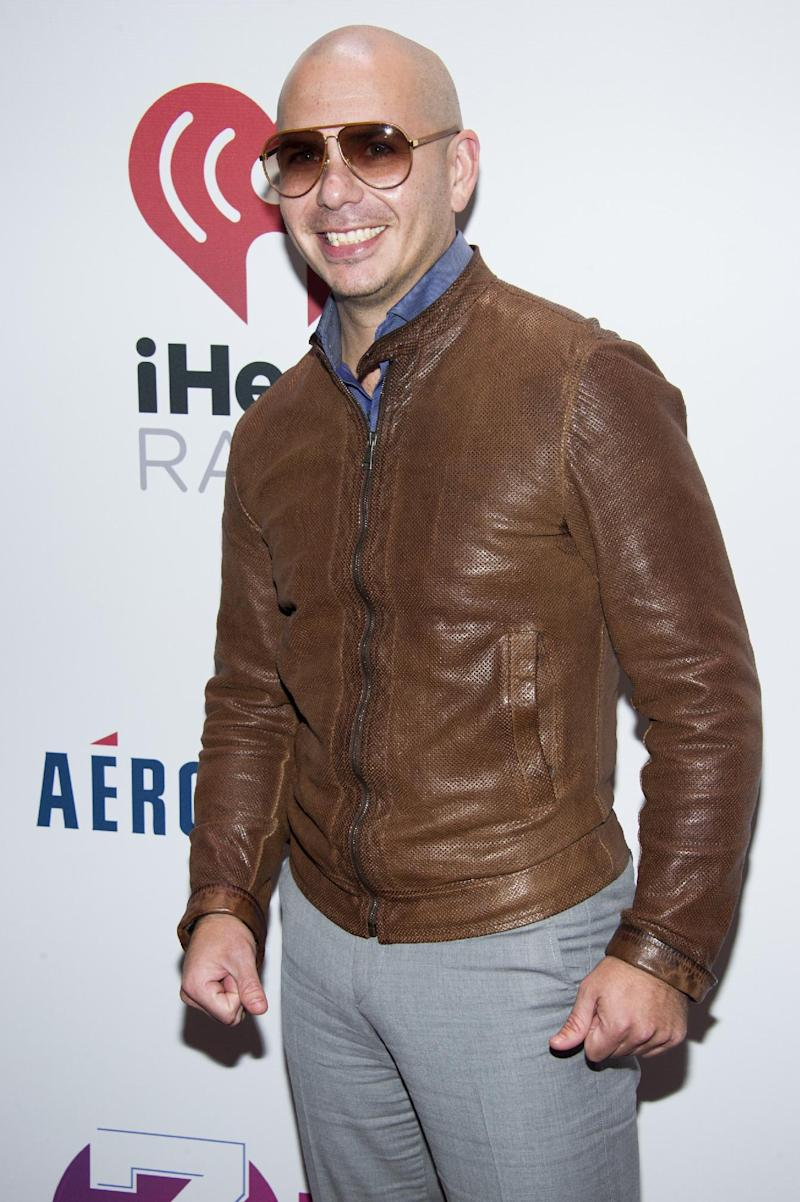 Pitbull attends Z100's Jingle Ball presented by Aeropostale on Friday, Dec. 13, 2013, in New York. (Photo by Charles Sykes/Invision/AP)