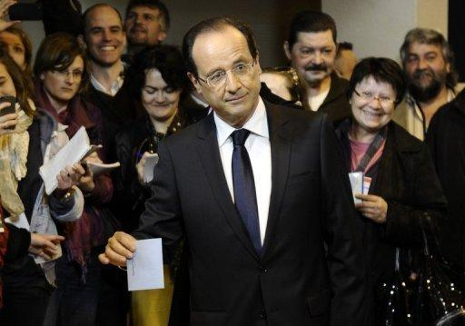 French Socialist Party (PS) candidate Francois Hollande (C) casts his ballot for the second round of the French presidential election, on May 6 in Tulle, southwest France