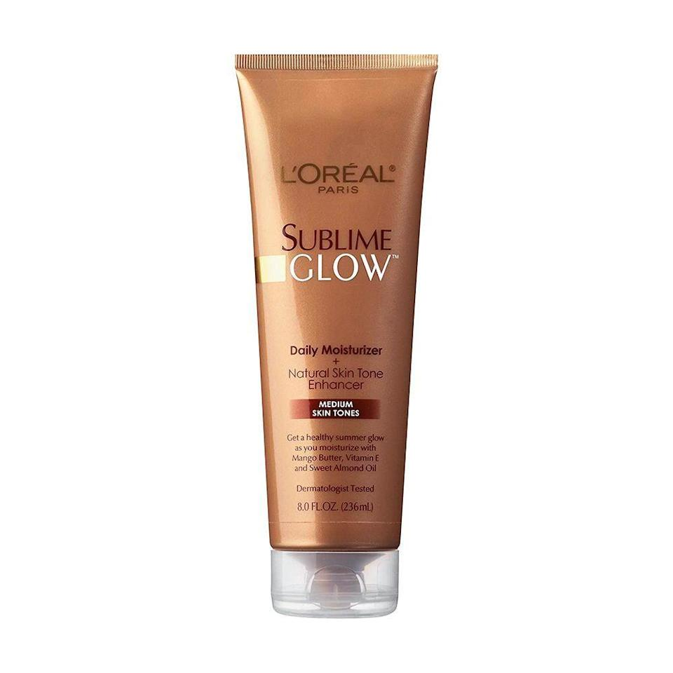 """<p><strong>L'Oreal </strong></p><p>amazon.com</p><p><strong>$7.99</strong></p><p><a href=""""https://www.amazon.com/dp/B000NPWQU4?tag=syn-yahoo-20&ascsubtag=%5Bartid%7C2089.g.30744763%5Bsrc%7Cyahoo-us"""" rel=""""nofollow noopener"""" target=""""_blank"""" data-ylk=""""slk:Shop Now"""" class=""""link rapid-noclick-resp"""">Shop Now</a></p><p>This skin tone enhancer from L'Oréal Paris hydrates as it tints. It gives the perfect amount of color to disguise any discolorations in your skin, while ingredients like almond oil knock out any dryness.</p>"""