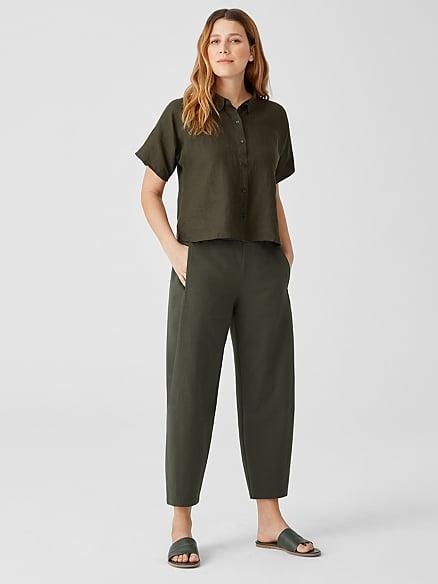 """<p>Elieen Fisher is not only eco-friendly but affordable, too. The brand mission pretty much sums it up: """"Make ethical, timeless clothes designed to work together, wear effortlessly and be part of a responsible lifecycle.""""</p> <p><strong>What We'd Buy</strong>: <span>Organic Cotton Ponte Lantern Pant</span> ($168)</p>"""