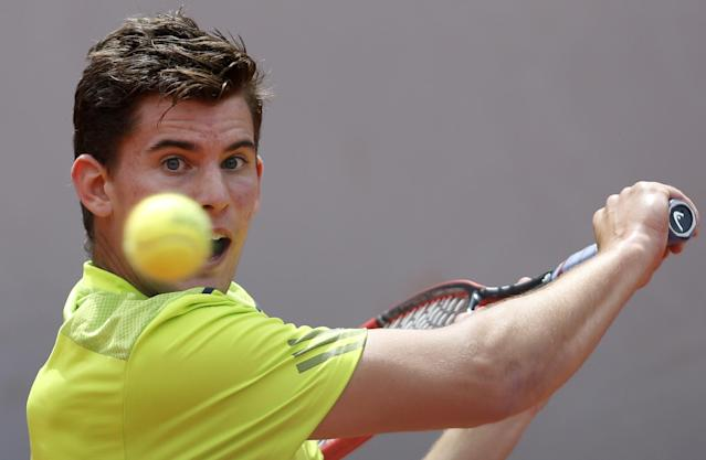 Austria's Dominic Thiem returns the ball to Spain's Rafael Nadal during their second round match of the French Open tennis tournament at the Roland Garros stadium, in Paris, France, Thursday, May 29, 2014. (AP Photo/Darko Vojinovic)