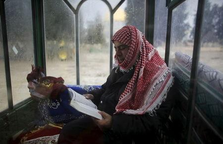 A security guard for the Waqf, the custodians of Muslim sites in Jerusalem, sits in a guard booth with foggy windows on the compound know to Muslims as al-Haram al-Sharif and to Jews as Temple Mount in Jerusalem's Old City in this January 7, 2013 file photo. REUTERS/Ammar Awad/Files
