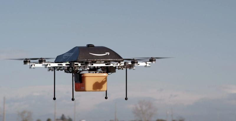 This undated image provided by Amazon.com shows the so-called Prime Air unmanned aircraft project that Amazon is working on in its research and development labs. Amazon says it will take years to advance the technology and for the Federal Aviation Administration to create the necessary rules and regulations, but CEO Jeff Bezos said Sunday Dec. 1, 2013, there's no reason Drones can't help get goods to customers in 30 minutes or less. (AP Photo/Amazon)
