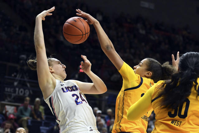 Connecticut's Anna Makurat (24) is fouled by California's Evelien Lutje Schipholt (24) in the first half of a women's NCAA college basketball game, Sunday, Nov. 10, 2019, in Storrs, Conn. (AP Photo/Stephen Dunn)