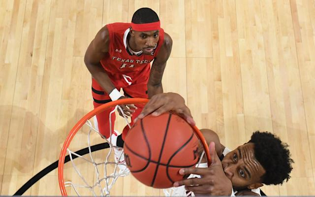 Braxton Key #2 of the Virginia Cavaliers dunks on Tariq Owens #11 of the Texas Tech Red Raiders during the first half in the 2019 NCAA men's Final Four National Championship game at U.S. Bank Stadium on April 08, 2019 in Minneapolis, Minnesota. (Photo by Brett Wilhelm/NCAA Photos via Getty Images)