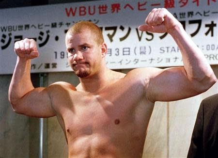 HIV infected heavyweight boxer and former WBO champion Tommy Morrison of the United States poses during a weigh-in in Tokyo in this November 2, 1996 file photo. REUTERS/Kimimasa Mayama/Files