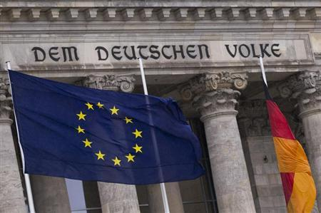 EU flag and German national flag fly outside the Reichstag, seat of Germany's lower house of parliament, in Berlin